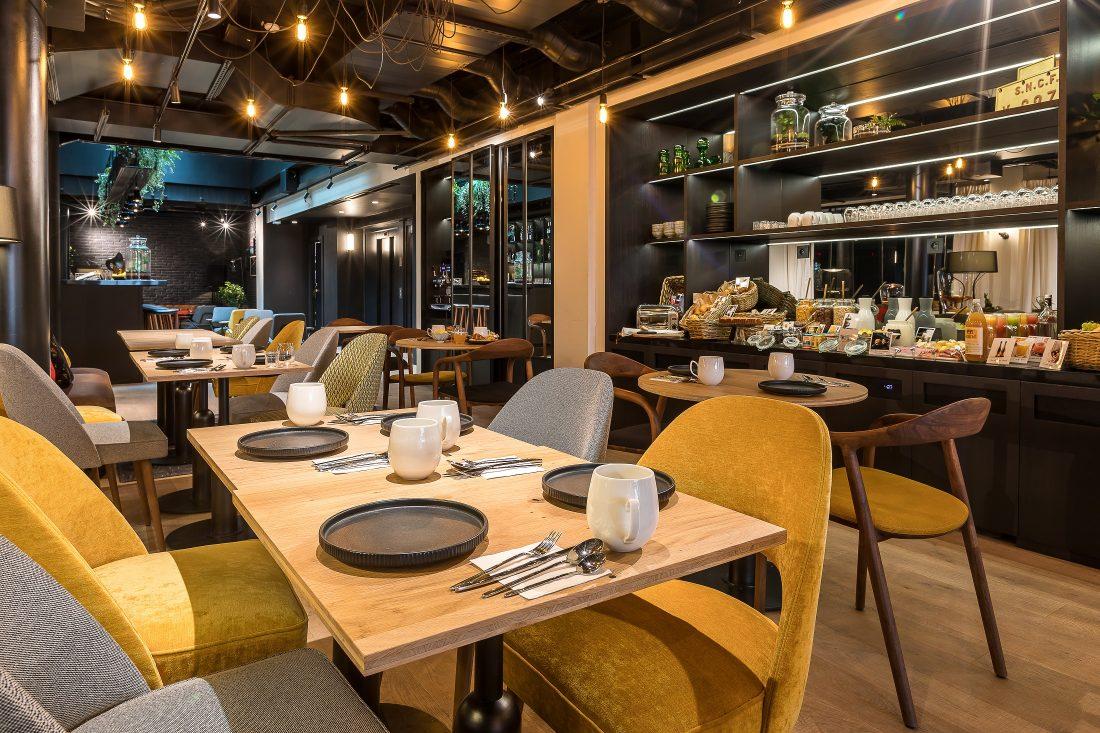 Salle de petit déjeuner du LAZ' Hôtel Spa Urbain Paris Saint-Lazare, boutique-hôtel 4 étoiles du parc hôtelier Suitcase Hospitality